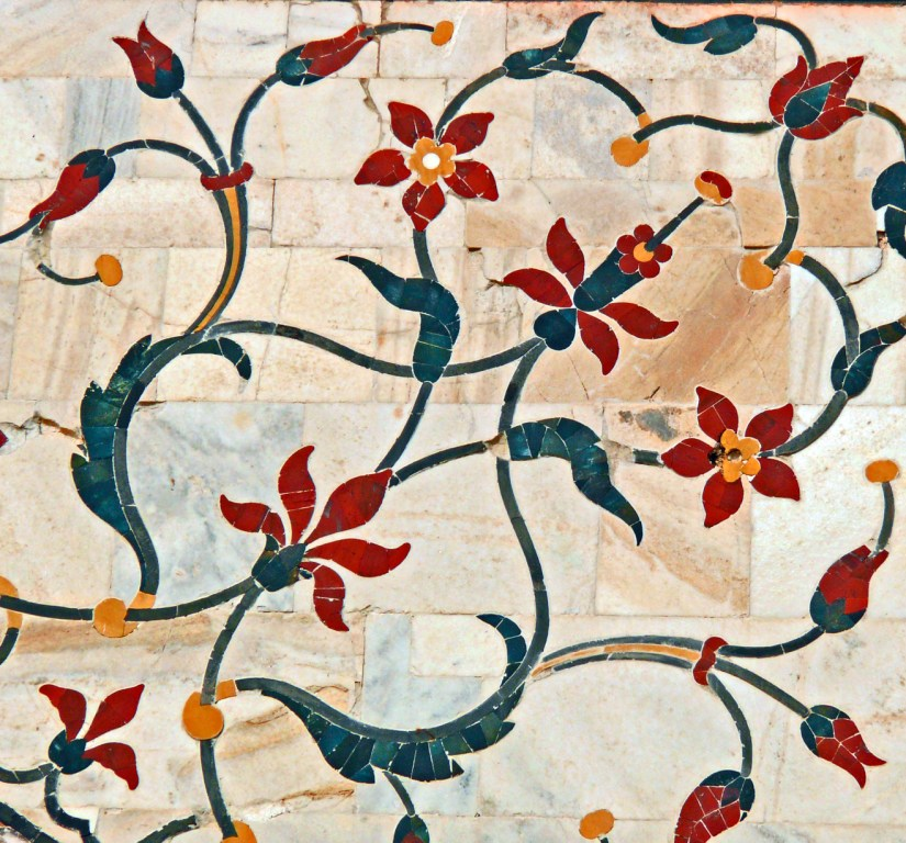 The remaining surfaces have been inlaid with semiprecious stones in extremely delicate detail, forming twining vines, fruits and flowers.
