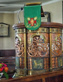 The Arts and Crafts style pulpit in copper and brass was given by Mrs Morris in 1892.